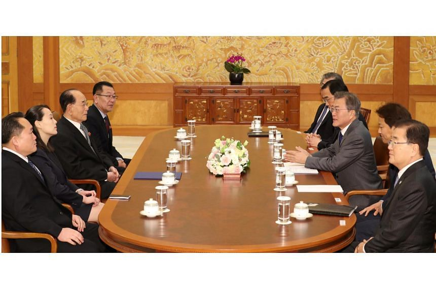 South Korean President Moon Jae In talks to the President of the Presidium of the Supreme People's Assembly of North Korea Kim Young Nam and Kim Yo Jong, the sister of Kim Jong Un, during their meeting at the Presidential Blue House in Seoul, on Feb
