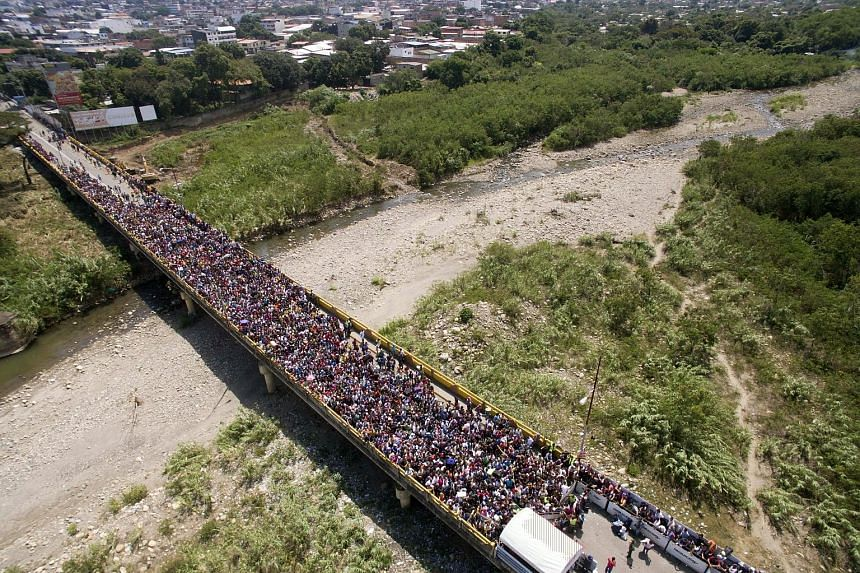 An aerial view of thousands of Venezuelans trying to enter Colombia through the border crossing of Cucuta on the Simon Bolivar International Bridge in Cucuta, Colombia, on Friday. Colombia and Brazil tightened border controls with Venezuela on Thursd