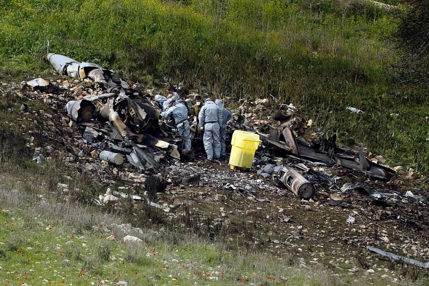 The remains of an Israeli F-16 that crashed in the northern village of Harduf in Israel yesterday after it came under fire from Syrian air defences during attacks against Iranian targets in Syria.