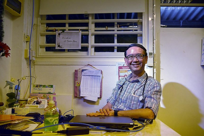 Above: Dr Goh Wei Leong in the HealthServe clinic in Lorong 23 Geylang. He co-founded the charity in 2006 with Mr Tang Shin Yong to help migrant workers. Left: Last Tuesday, Dr Goh and HealthServe won The Straits Times Singaporean Of The Year award.