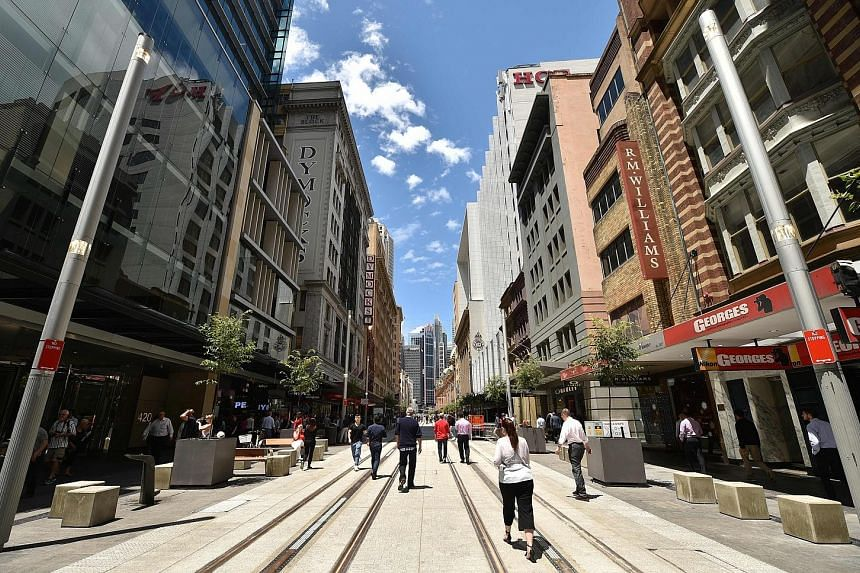 Mr Mark Shaw (left), who has headed the Orchard Road Business Association since 2015, is optimistic that an ongoing study on the shopping precinct will lead to changes that will enliven it. He sees Sydney's George Street (below) as an example of an e