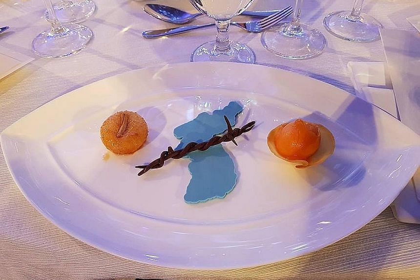 Dessert at the Winter Games' party illustrated the melting of frosty ties between South and North Korea.