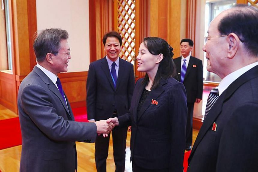 South Korea's President Moon Jae In (left) greets North Korean leader Kim Jong Un's sister Kim Yo Jong (centre) as North Korea's ceremonial head of state Kim Yong Nam (right) looks on before their meeting at the presidential Blue House in Seoul on Fe