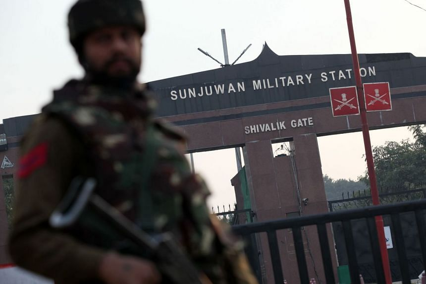 An Indian soldier standing guard at the gate of Sunjuwan Military Station in Jammu on Feb 10, 2018.