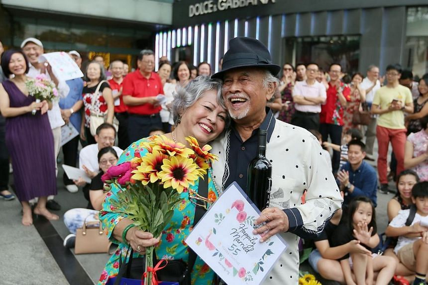 Ms Marlene De Silva (left) and Mr Penny D'Rozario celebrating being the longest married couple - 55 years- at the World Marriage Day event at ION Orchard on Feb 11, 2018.