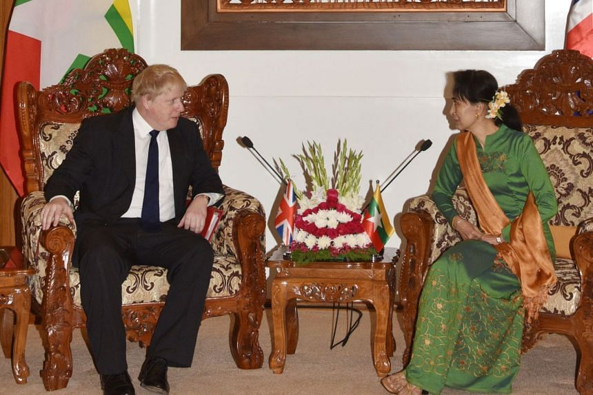 British Foreign Minister Boris Johnson speaking with Myanmar State Counsellor Aung San Suu Kyi at a meeting in Naypyidaw on Feb 11, 2018.