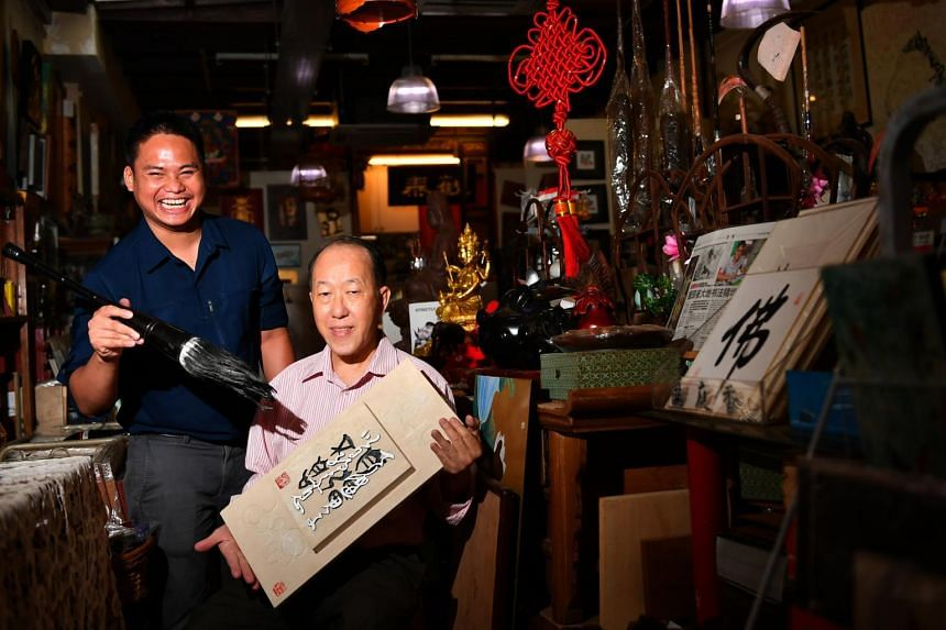 Mr Malik Mazlan (left), who does Chinese calligraphy, and his mentor acclaimed calligrapher Yong Cheong Thye.