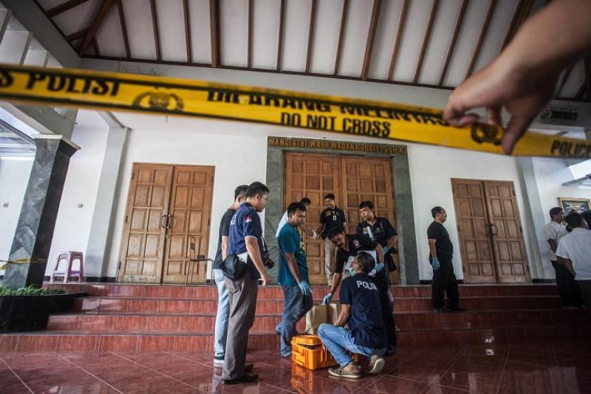 Police investigators working at the scene of the knife attack at the St Lidwina Church in Sleman, Yogyakarta, on Feb 11, 2018.