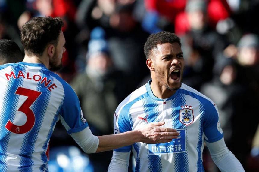 Huddersfield Town striker Steve Mounie (right) celebrating after scoring against Bournemouth during their EPL match on Feb 11, 2018.