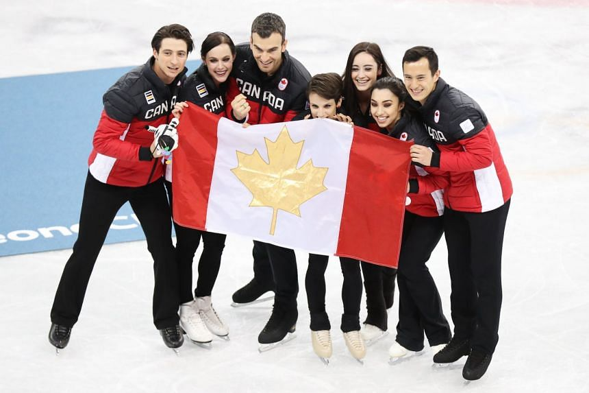 (From left) Ice dancers Scott Moir and Tessa Virtue, pair skaters Eric Radford and Meagan Duhamel, and singles skaters Kaetlyn Osmond, Gabrielle Daleman and Patrick Chan celebrate their figure skating team event win, on Feb 12, 2018.