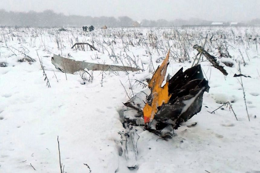 Debris of the crashed Russian Saratov Airlines Antonov AN-148 passenger plane lies in the snow near the Stepanovskoy village in Russia, on Feb 11, 2018.