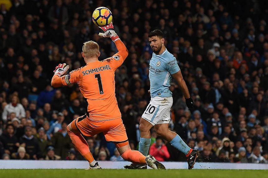 Manchester City striker Sergio Aguero chipping the ball over Leicester goalkeeper Kasper Schmeichel to score his third goal and his team's fourth in the 5-1 Premier League win at the Etihad Stadium in Manchester on Saturday.