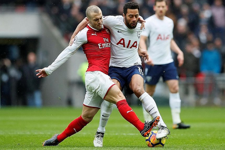 Arsenal's Jack Wilshere tussling for possession with Tottenham's Mousa Dembele. Like his manager, the Englishman is optimistic that the Gunners can rebound from their derby defeat and put together a good run to get back into the Premier League's top