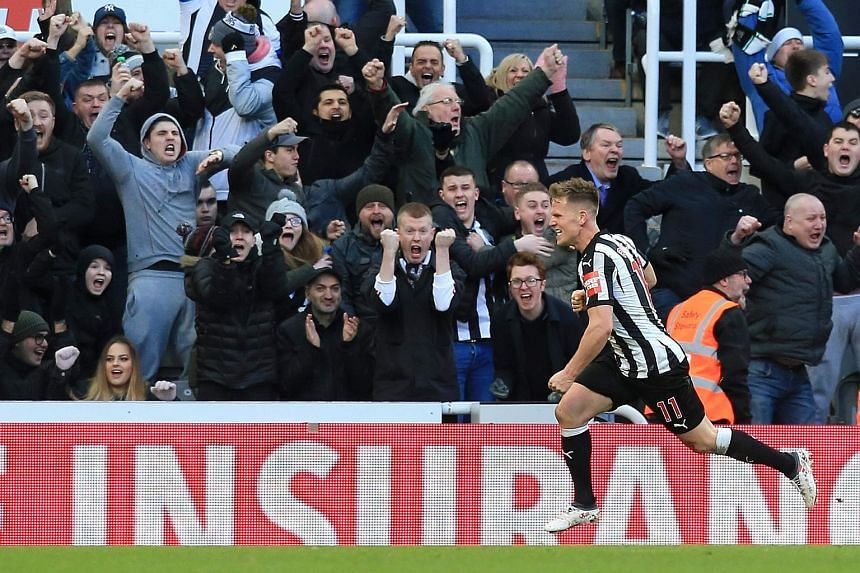 Matt Ritchie running to celebrate his strike with the delirious St James' Park crowd, after putting Newcastle in the lead against Manchester United in the 65th minute yesterday. The 1-0 victory for the hosts means Jose Mourinho is yet to win at Newca