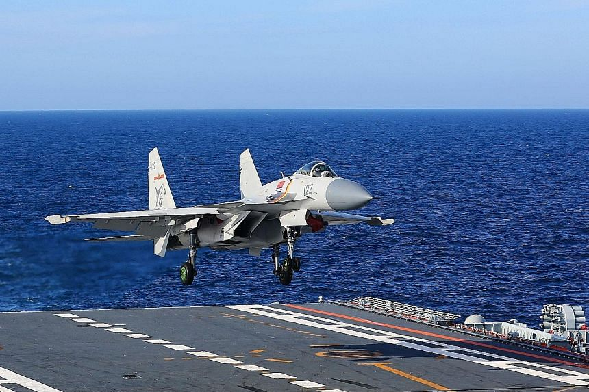 A J-15 fighter jet landing on the Chinese aircraft carrier Liaoning last year. China had more than 700 fourth-generation fighter jets last year, compared to 24 in 1996, the US-based Rand Corporation estimates.