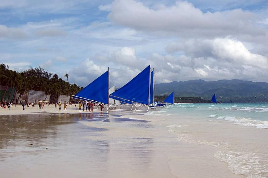 """Sailboats on the beach in Boracay. Philippines President Rodrigo Duterte called the resort island """"a cesspool"""", adding that the sewage and garbage problem was destroying the island's ecosystem and posing a threat to the health of millions of visitors"""