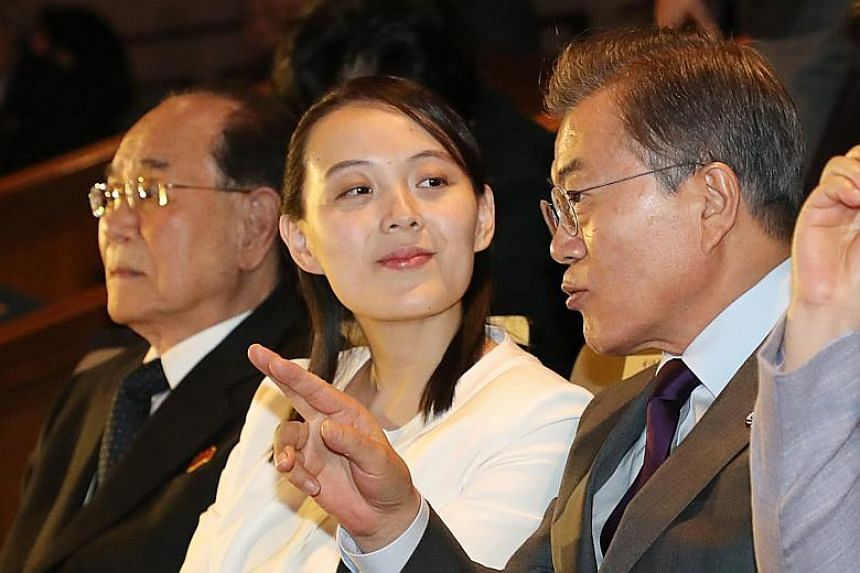 South Korean President Moon Jae In (right) talks with North Korean leader Kim Jong Un's sister Kim Yo Jong (centre) as they watch a concert of Pyongyang's Samjiyon Orchestra at a national theatre in Seoul on Feb 11, 2018.