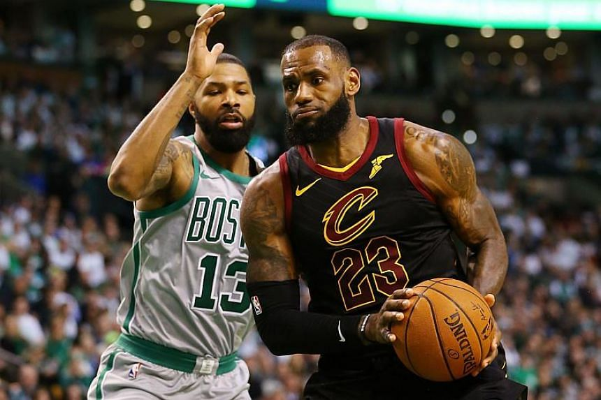 Lebron James of the Cleveland Cavaliers drives to the basket past Marcus Morris of the Boston Celtics during the first quarter of a game at TD Garden on Feb 11, 2018.