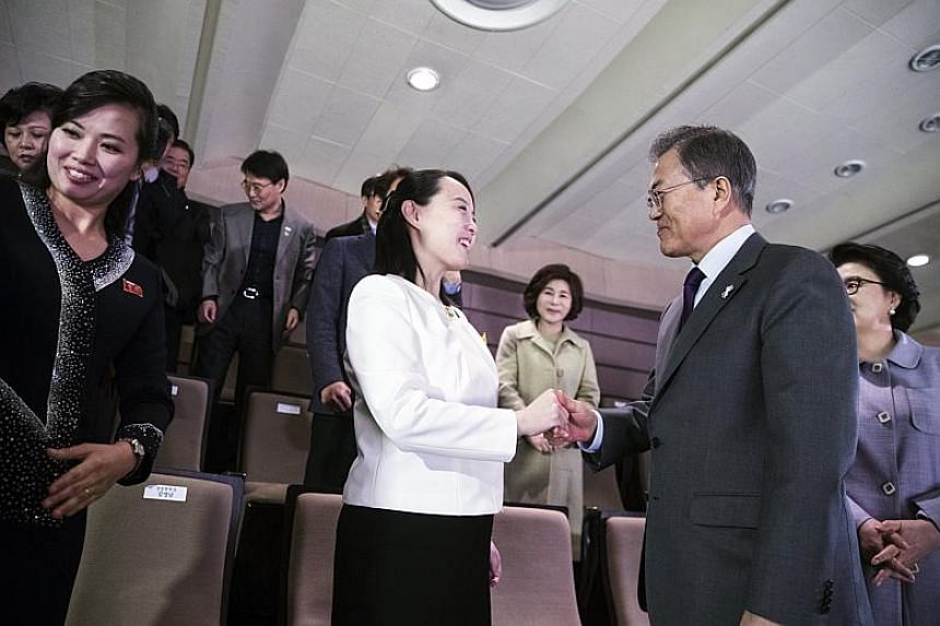 South Korean President Moon Jae In (right) shaking hands with the sister of North Korean leader Kim Jong Un, Kim Yo Jong (centre) as they attend a concert, staged by the North's Samjiyon Orchestra at the National Theater of Korea in Seoul, South Kore
