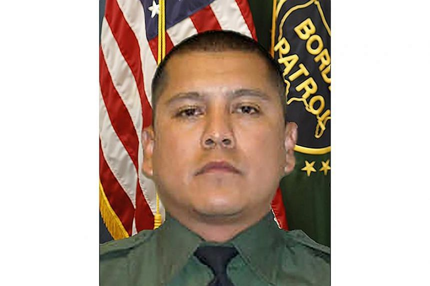 US Border Agent Rogelio Martinez (above), 36, who died while patrolling in a remote part of west Texas.