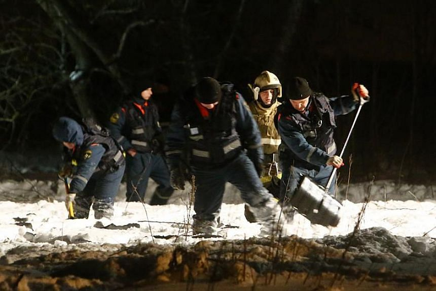 Emergency services work at the scene where a Saratov Airlines Antonov AN-148 plane crashed after taking off from Moscow's Domodedovo airport, outside Moscow, Russia on Feb 11, 2018.