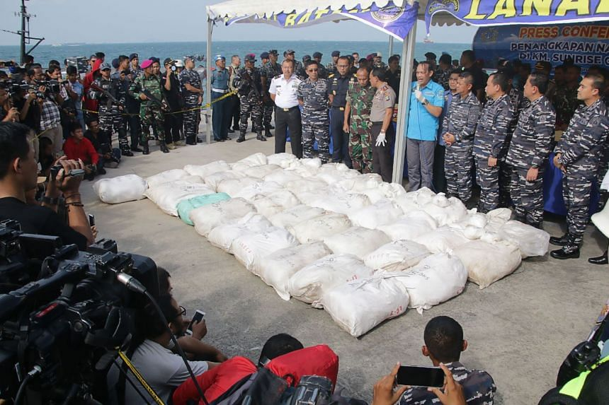 """Indonesian officials displaying more than a tonne of methamphetamine that was seized from the fishing vessel """"Sunrise Glory"""" off Batam, on Feb 10, 2018."""