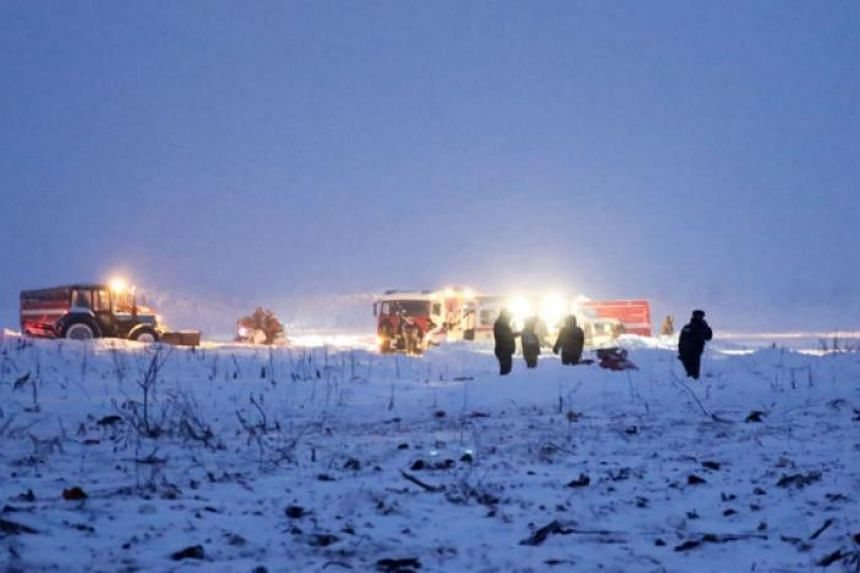 Fire fighters and emergencies ministry rescue staff arriving at the site of the plane crash near Argunovo, Ramensky district, Moscow region, Russia, on Feb 11, 2018.