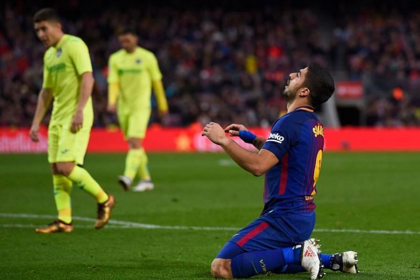 Barcelona's Uruguayan forward Luis Suarez kneels on the field during the Spanish league football match between FC Barcelona and Getafe CF at the Camp Nou stadium in Barcelona on Feb 11, 2018.