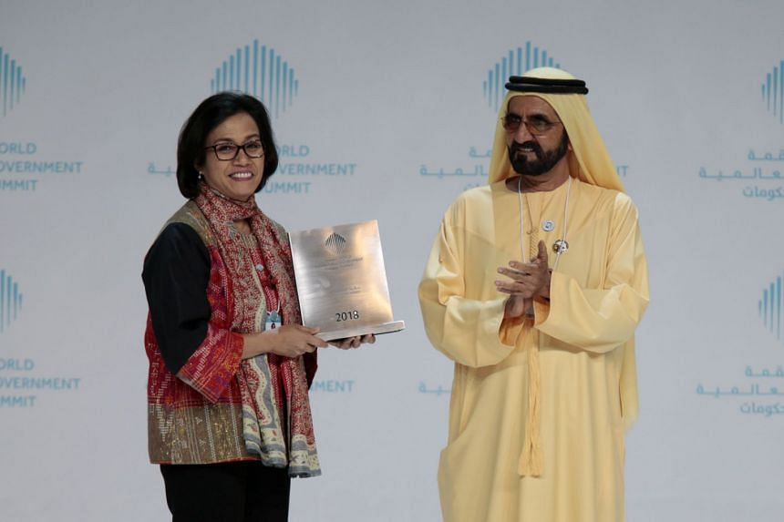 Indonesia's Minister of Finance Sri Mulyani Indrawati receiving the Best Minister Award from Sheikh Mohammed bin Rashid al-Maktoum, Prime Minister and Vice-President of the United Arab Emirates, and ruler of Dubai, on Feb 11, 2018.