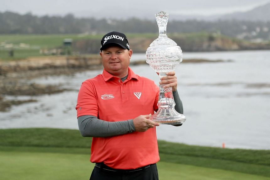 Ted Potter Jr. poses with the trophy after winning the AT&T Pebble Beach Pro-Am at Pebble Beach Golf Links, on Feb 11, 2018.