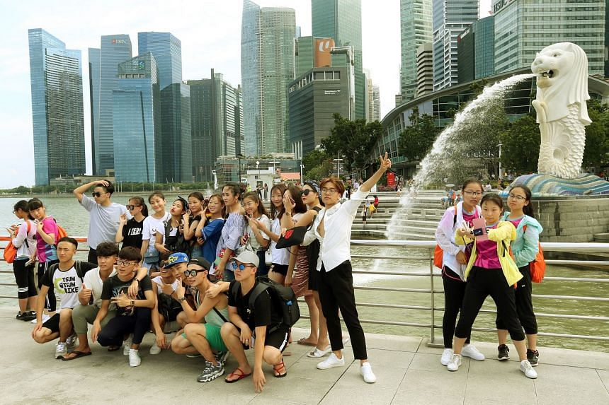 Chinese tourists posing for photographs at Merlion Park. In 2017, 3.2 million tourists from China arrived in Singapore, beating traditional chart leader Indonesia, which accounted for three million tourists.