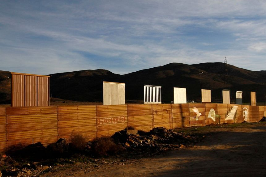 Prototypes for US President Trump's border wall with Mexico are seen behind the current border fence in this picture taken in Tijuana, Mexico, on Jan 27, 2018.