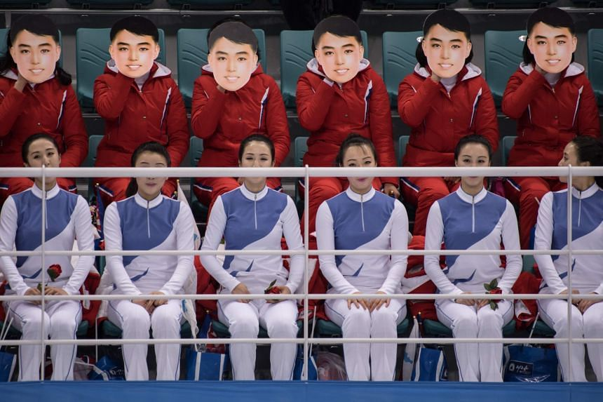 North Korean cheerleaders wearing masks as they perform during the women's preliminary round ice hockey match between the unified Korea team and Switzerland at the Pyeongchang 2018 Winter Olympics, on Feb 10, 2018.