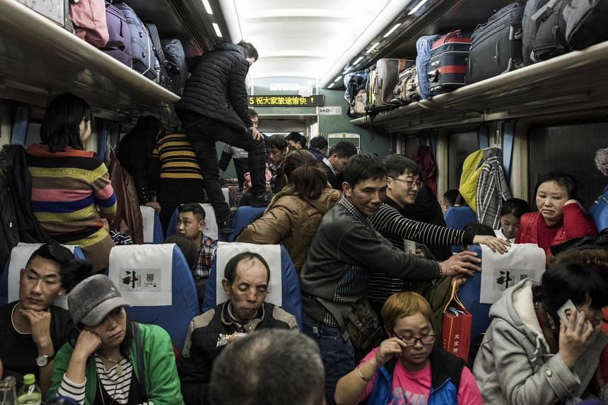 Passengers travelling on a crowded train during the 26-hour journey from Beijing to Chengdu, in Shijiazhuang, as they head home ahead of Chinese New Year, on Feb 10, 2018.