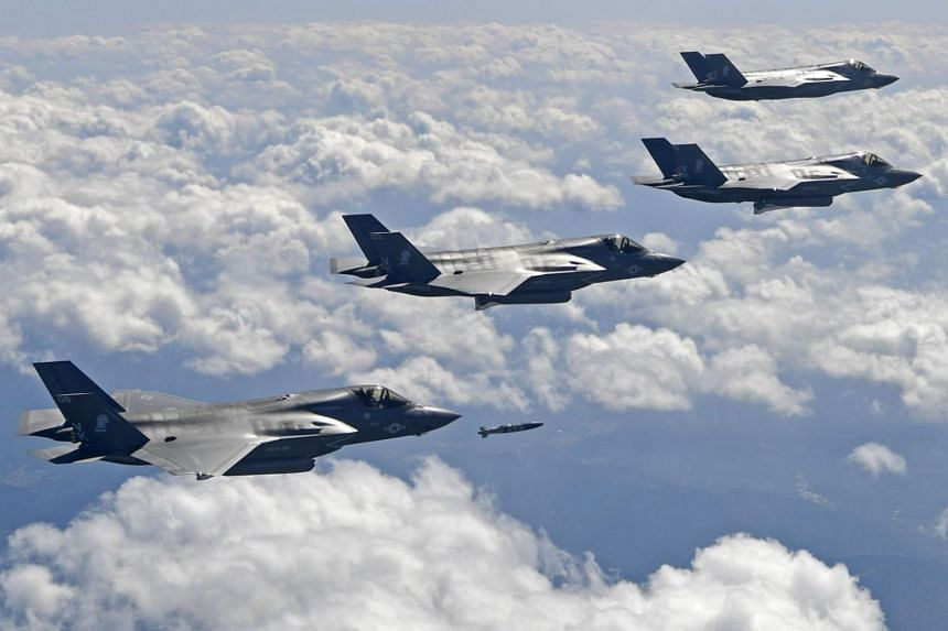 US F-35B stealth jet fighters dropping bombs at a shooting range in Korea on Sept 18, 2017.