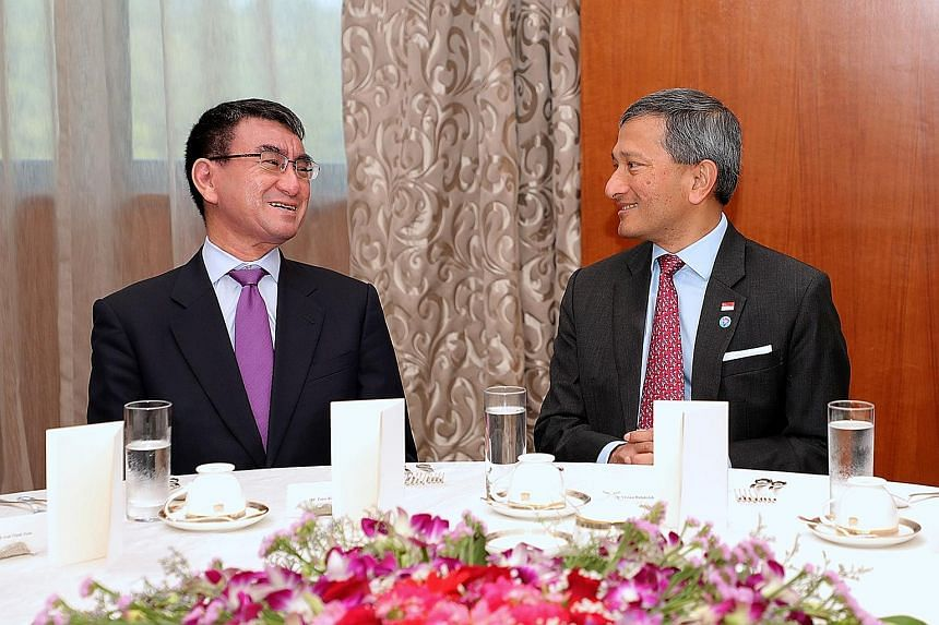 Foreign ministers Vivian Balakrishnan and Mr Taro Kono at a breakfast meeting yesterday. Both ministers agreed to tackle the issue of ships transferring oil to North Korean ships at sea and that both Singapore and Japan will fully implement UN Securi