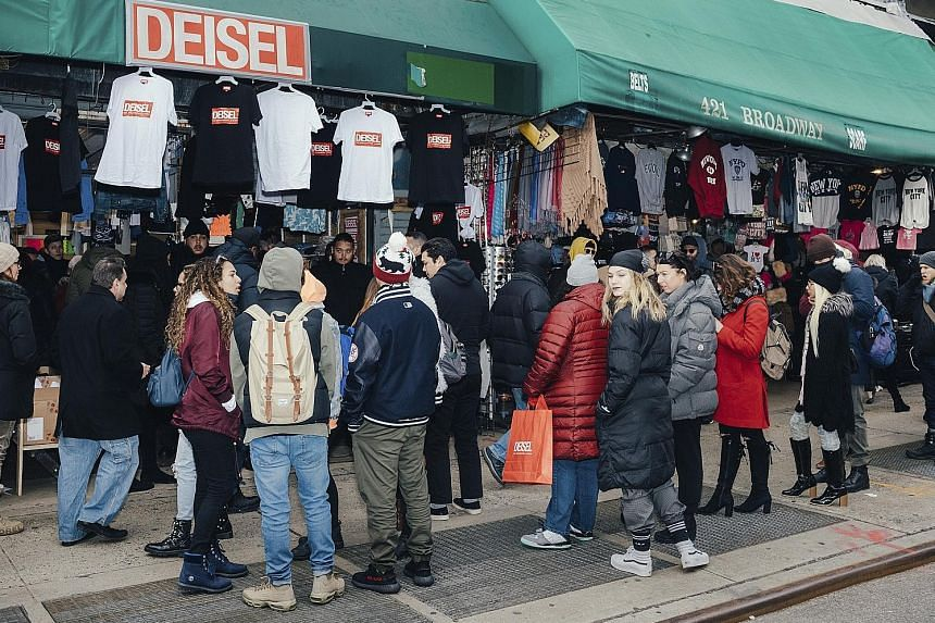 Shoppers at a faux Diesel pop-up shop in Canal Street in New York waiting to snap up clothes with an almost-right logo.