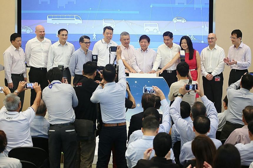 Transport Minister and Coordinating Minister for Infrastructure Khaw Boon Wan (seventh from left) and transport officials launching the Land Transport Industry Transformation Map yesterday at the PSA Building. They are (from left): Mr Yeo See Peng, S