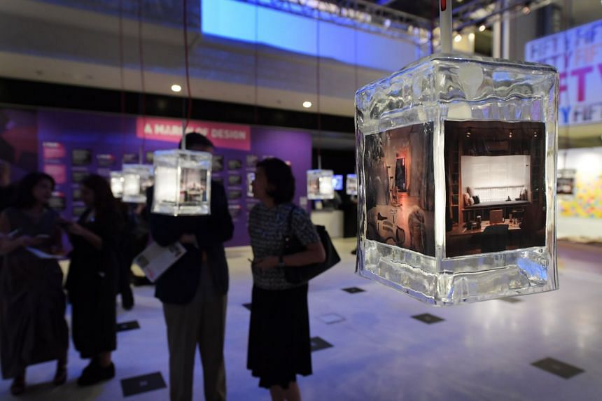 Guests viewing the Frontliners in Action exhibition at the opening of Singapore Design Week 2017, on March 3, 2017.