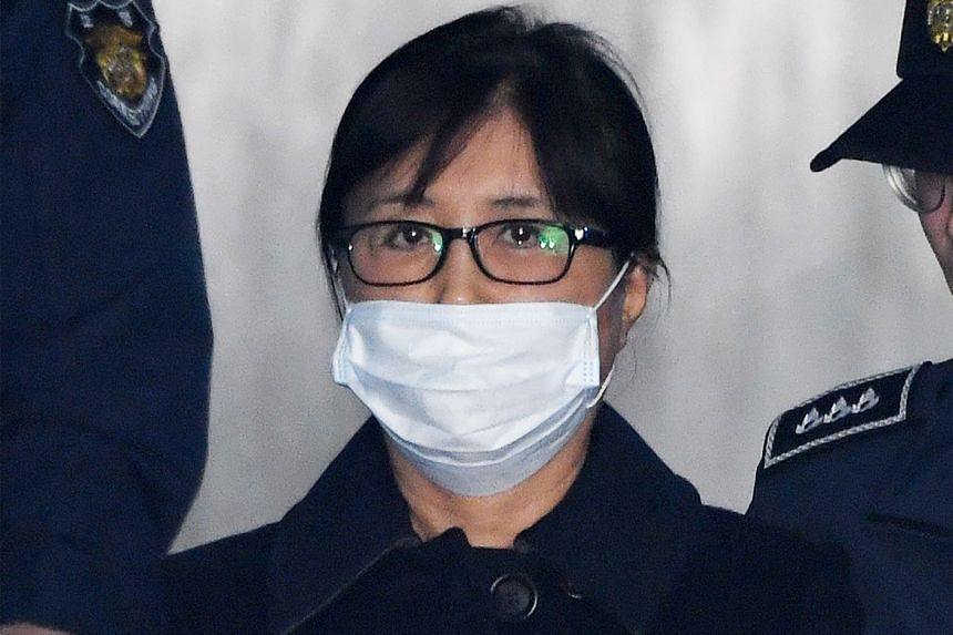 Choi Soon Sil arriving at the Seoul Central District Court in Seoul for the verdict on her case, on Feb 13, 2018.