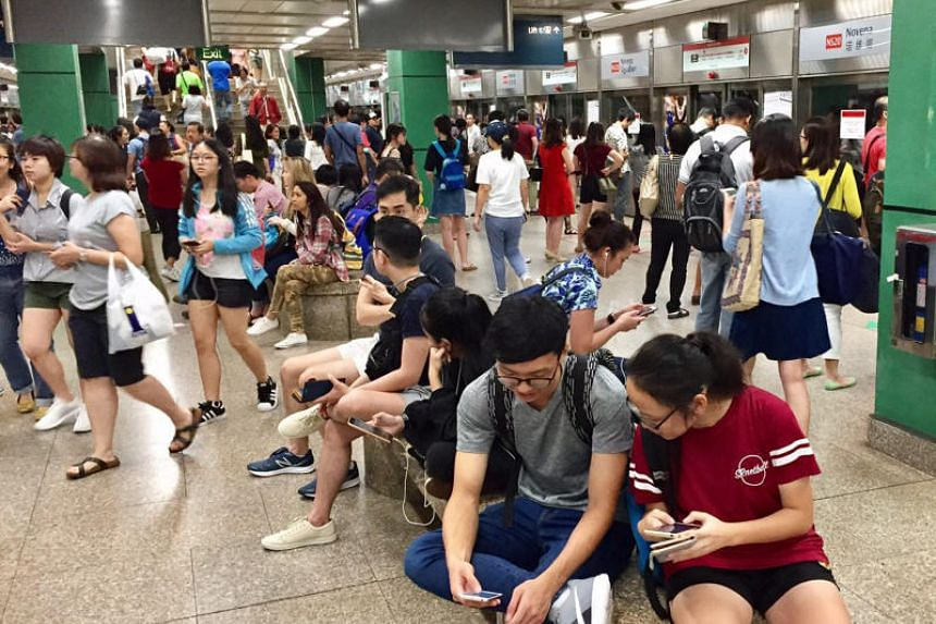 Commuters waiting at Novena MRT station at 6.20pm on Oct 7, 2017, following a train disruption.