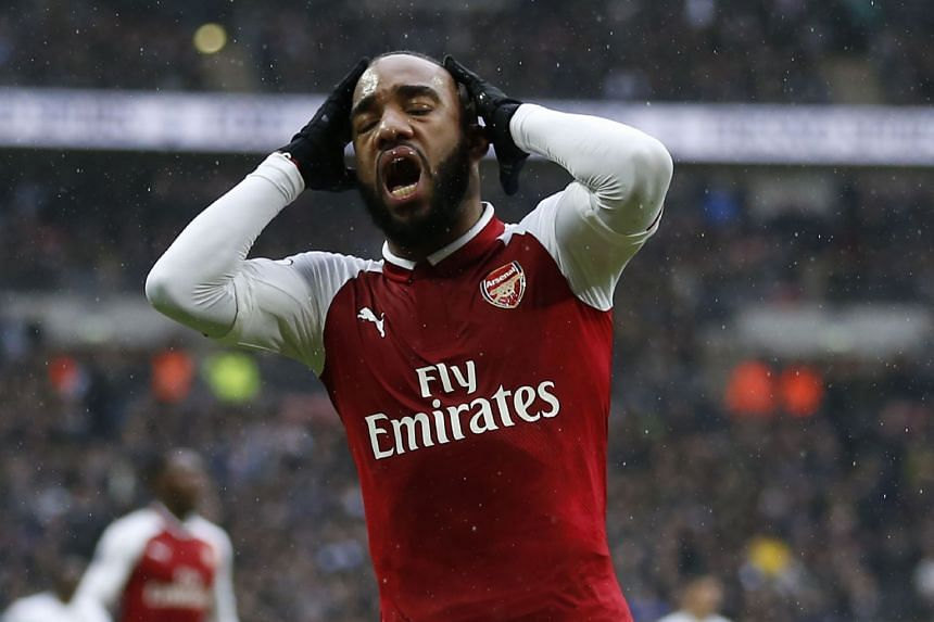 Lacazette reacts after missing a chance against Tottenham Hotspur, Feb 10, 2018.