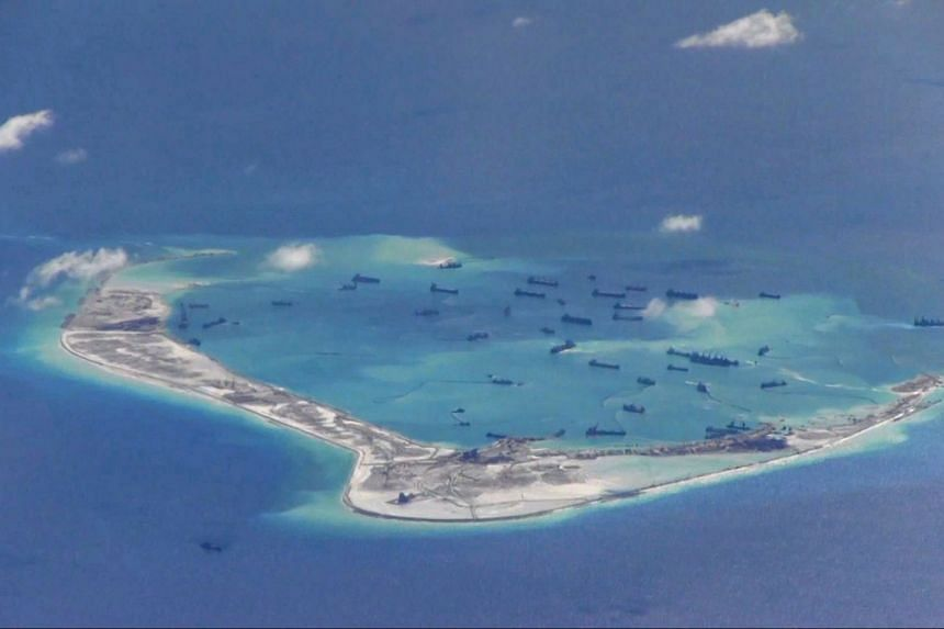 A file photo of Chinese dredging vessels purportedly seen in the waters around Mischief Reef in the disputed Spratly Islands in the South China Sea, on May 21, 2015.