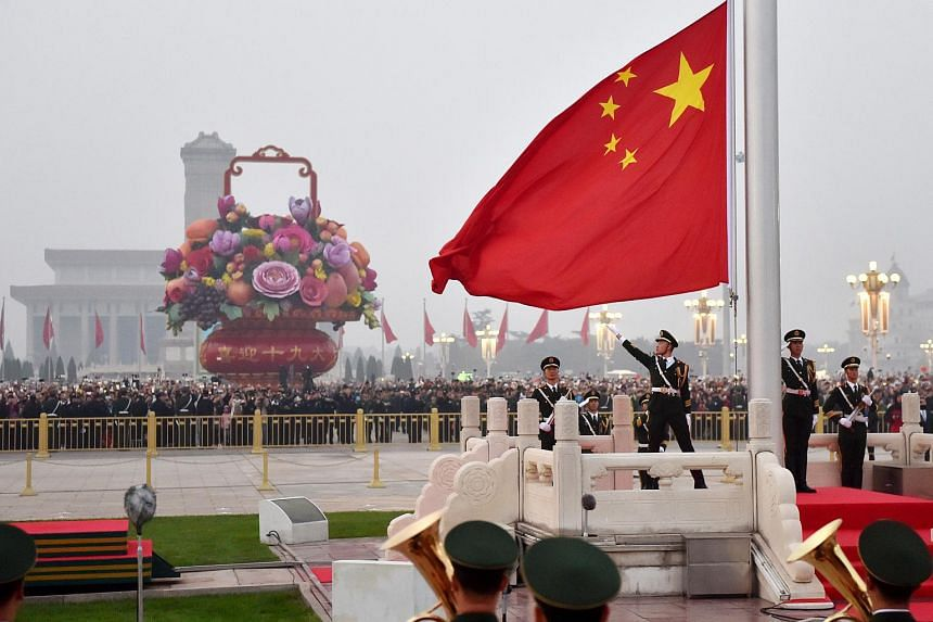 A flag-raising ceremony taking place during China's National Day at Tiananmen Square in 2017.