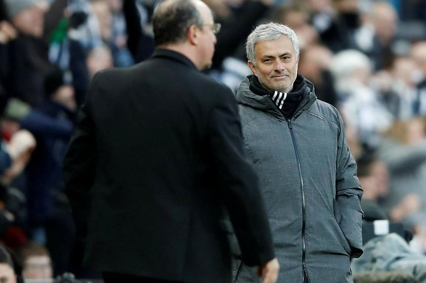 Manchester United manager Jose Mourinho with Newcastle United manager Rafael Benitez at the end of the match.