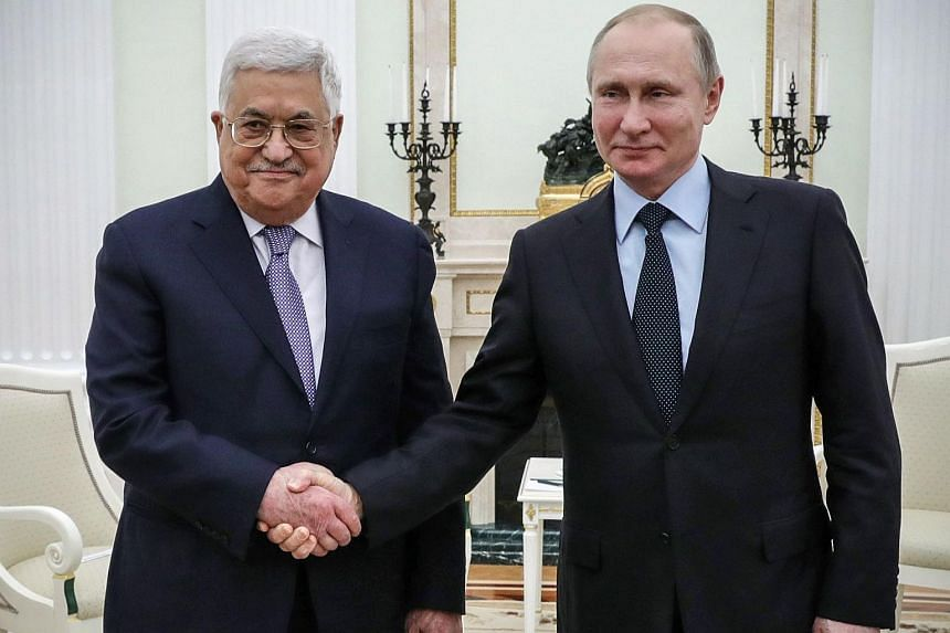 Russian President Vladimir Putin (right) shakes hands with Palestinian leader Mahmud Abbas during their meeting at the Kremlin in Moscow on Feb 12, 2018