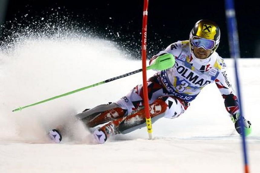 Marcel Hirscher climbed from an unexpectedly high 12th place after the downhill segment at the Jeongseon Alpine Centre to pip France's Alexis Pinturault by 0.23 of a second.