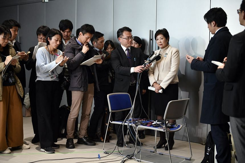 Tokyo Governor Yuriko Koike answers questions from reporters after a media tour at the new Toyosu Wholesale Market in Tokyo, on Feb 13, 2018.