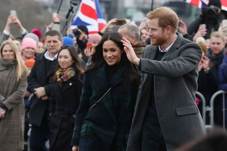 Prince Harry and his fiancée Meghan Markle meet members of the public during a walkabout on the Esplanade at Edinburgh Castle, on Feb 13, 2018.