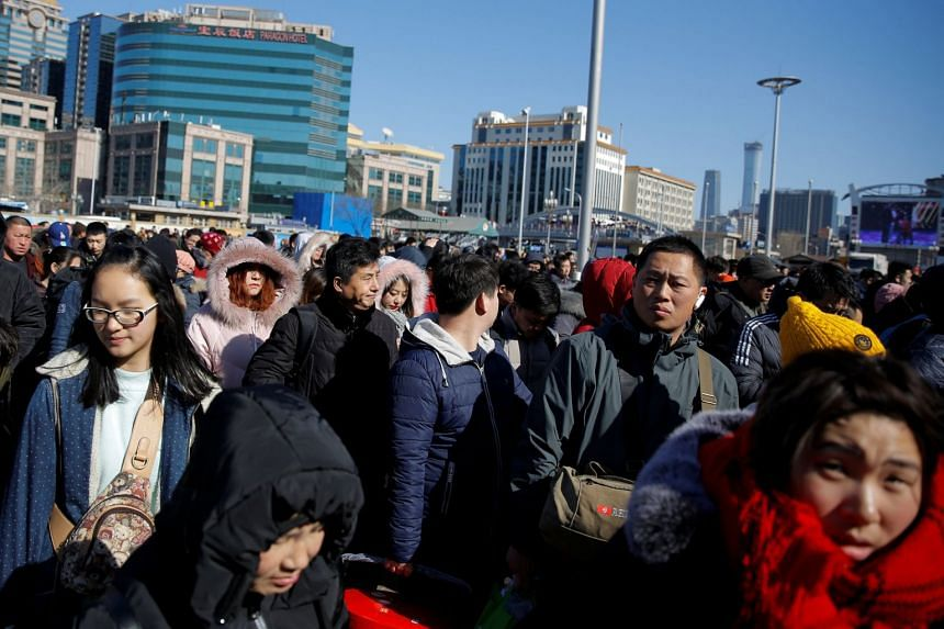 Crowds at the Beijing Railway Station on Feb 12, 2018. China said it would be relaxing controls on rights for rural land and vacant houses to allow those who moved to cities to develop or rent them out.